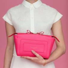 Mini Marylebone Clutch in Smooth Neon Pink. Handbags & Clutches from Aspinal of London