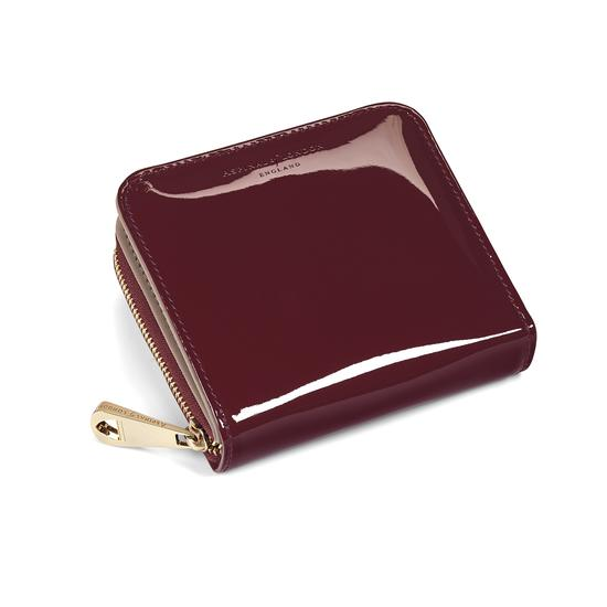 Mini Continental Zipped Coin Purse in Deep Shine Cherry Patent from Aspinal of London