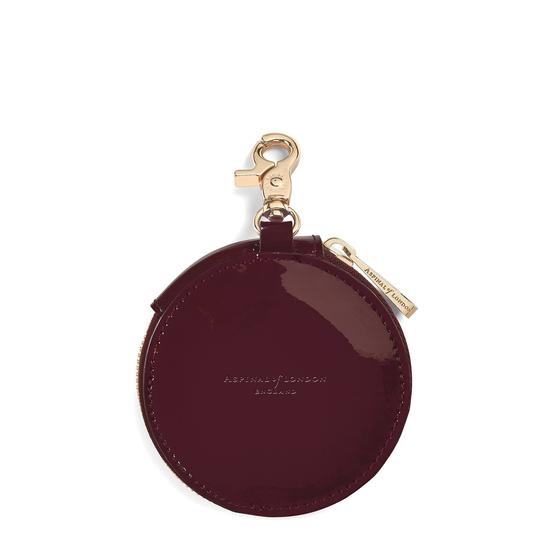 Round Coin Purse with Keyring in Deep Shine Cherry Patent from Aspinal of London
